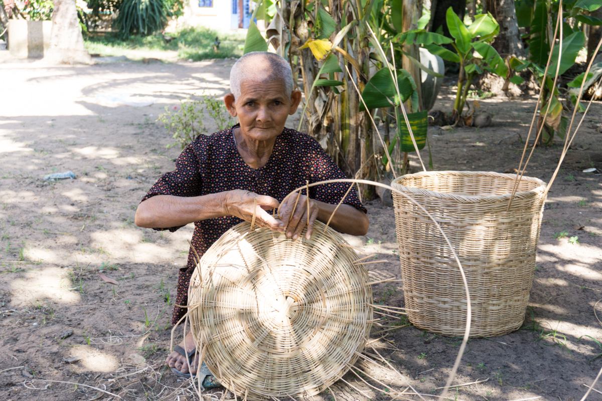 This woman sells her baskets for $3. She can complete one per day.